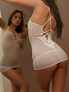 The sheer white chemise is skintight and Kate looks phenomenal in it.